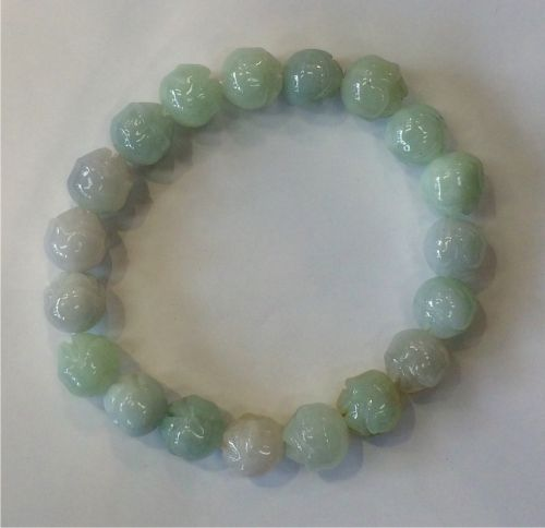Elasticated bracelet with 8mm jade beads and lotus flower